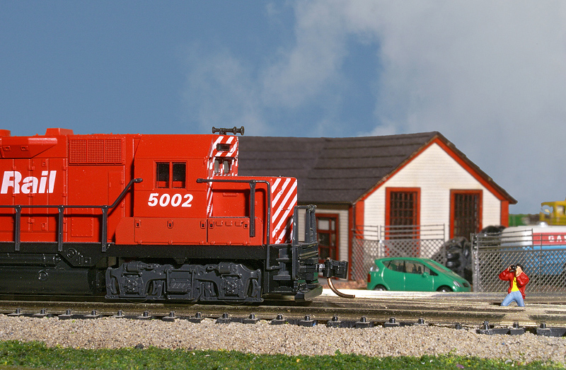 1:160 scale model train ('N' Scale). Sky was from a different photo. See the little photographer?