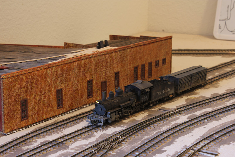 K-27 #454 becomes the first locomotive to run on the newly completed rail.<br /> <br /> The roundhouse in the background was completely scratch built, with the walls being made out of foam core material.  A full interior was added to the structure.