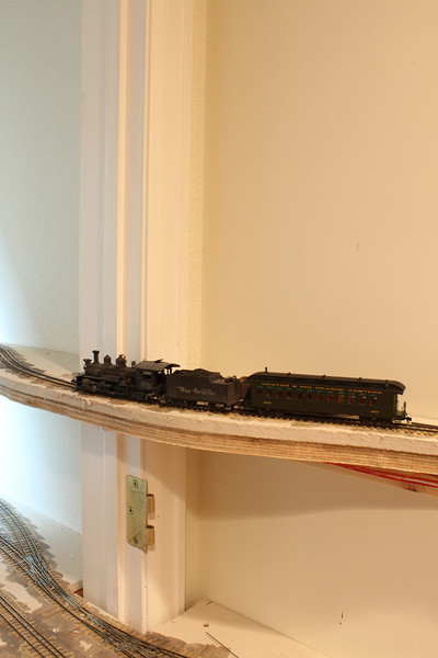 The inspection train makes its way to the closet and across to the next portion of the layout.