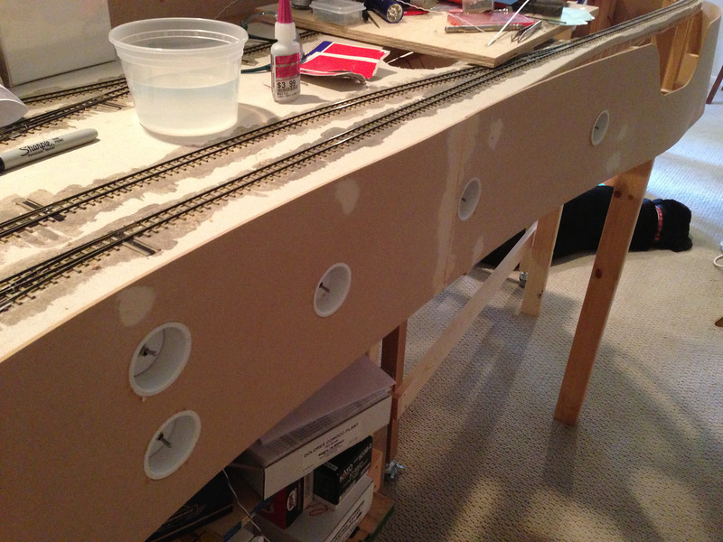 "Here is a shot of the facia line up at Cumbres.  Notice how I am handling the switches.  If one throw is directly above the switch I went down 5.5"".  If two were in the same area, I would go 3.5"" and 6"" from the top of the layout. <br /> <br /> To mount these in place I will use silicon so that they are removable if need be."