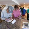 "David B and his wife sign the guest book at the NCMRC Layout Tour.  I started using a ""Guest Book"" to track all of the people that have visited the layout, an idea given by friend David Stewart.<br /> <br /> Photo by Bob Sobol."