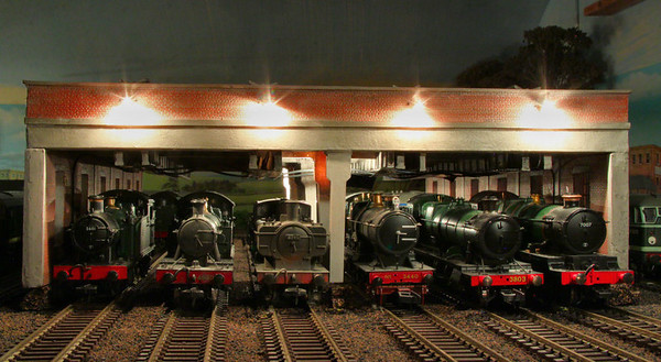 """GWR Prairie 4550, Pannier 8795, 3440 """"City of Truro"""" 28xx No 3803 and Castle No 7007 """"Great Western"""" line up on Barton Shed.  10/01/12"""