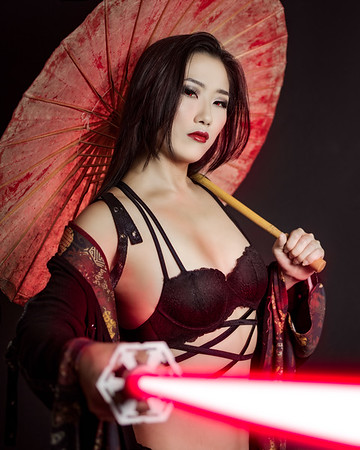 I've been wanting to do this concept of a girl with a parasol and alightsaber for a while.  Soft of a Star Wars Meets Sin City vibe.  I convinced Eri it woudl be a really sith concept.