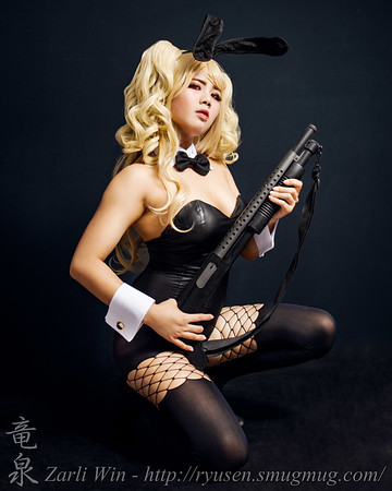 When she said she wanted to do a Bunny Costume, it wasn't hard ot gauge the best gun for her to pose with.