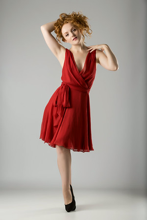 Ivory Flame Posing in Red Cocktail Dress