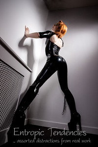 Ulorin Vex - black latex catsuit, make-up by Aileen Wallace.