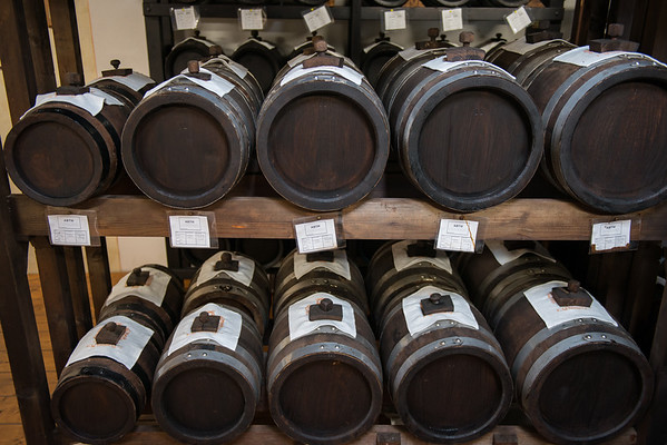 """A """"battery"""": A series of different sized barrels used to make balsamic vinegar"""