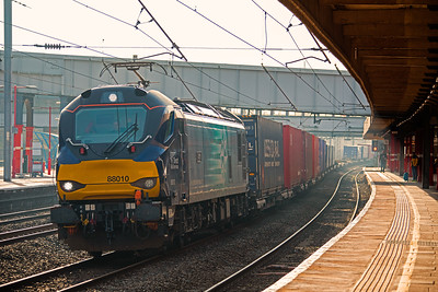 88010  'Aurora' glides through Lancaster on the 'down fast'  with 4S43,  the 06:16 Daventry-Mossend  'Tesco Express' on 23rd February 2019.