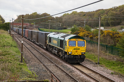 66593 rumbles along the West Coast main line at Woodacre with a southbound intermodal service.on 30th April 2018