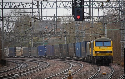 90.016 and an unidentified classmate approach Atherstone whilst working 4S44, the 12:13 Daventry-Coatbridge  intermodal on 6th March 2019.