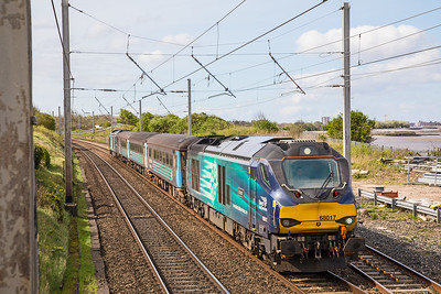 The 10.03 Preston - Barrow service approaches Hest Bank on 30.04.18.