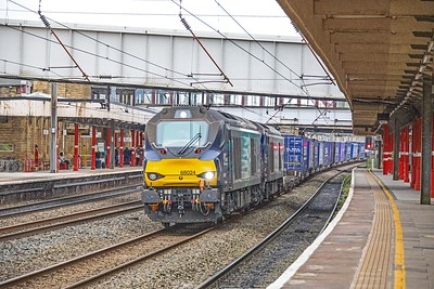 68024 leads classmate 68020 as they swing through the reverse curves on the 'down fast' at Lancaster with  the 06:16 Daventry-Mossend  'Tesco Express' on 7th April 2017.