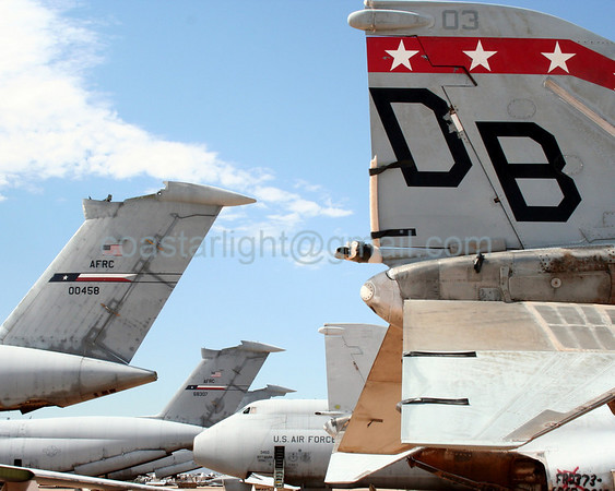 F-4 Phantom and C-5 Galaxy tails. July 20, 2006. AMARC... the Boneyard near Davis Monthan AFB, Tucson, AZ. © Brandon Lingle