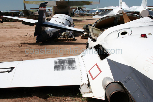 Cessna T-37 Tweets to be sold for scrap. C-130 Hercules in background. July 20, 2006. AMARC... the Boneyard near Davis Monthan AFB, Tucson, AZ. © Brandon Lingle