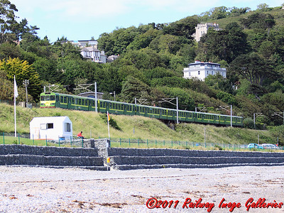 8340 leads a southbound DART service past Enya's castle home at Killiney on the 23rd June 2011 - RIGalleries