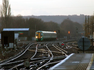 377 404 & 377 465 1XXX 0649 Hastings - Victoria approaches Three Bridge (0830) Monday 14th February 2011 - Colin Brooks