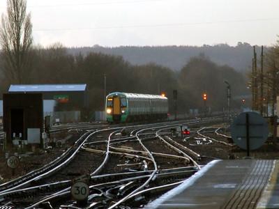 377 404 & 377 465 1XXX 0649 Hastings - Victoria approaches Three Bridge (0830) Monday 14th February 2011 - Colin Brooks