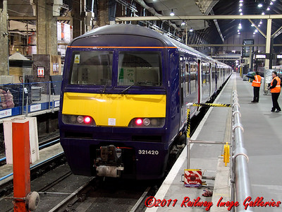 321420 and a sister unit await time at King's Cross on the 9th February 2011 - RIGalleries