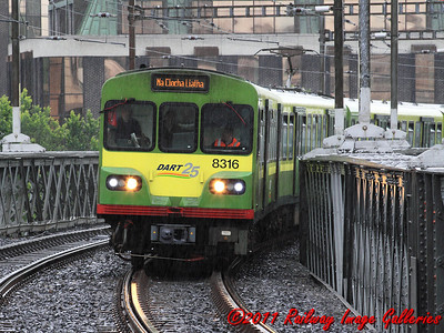 8100 Class DART set, 8116/8316, leads a pair of sister units across the bridge over the Liffey into Tara Street station on the 20th June 2011 - RIGalleries