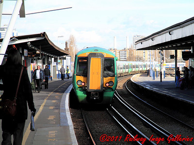 377467 brings up the rear of a Victoria bound service leaving Clapham Junction on the 14th February 2011 - RIGalleries