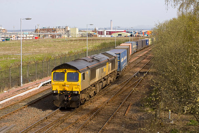 The Fastline liveried 66 departs Grangemouth with the Grangemouth- Aberdeen on 9th April 2011. - Peter Kellet