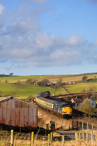 More of the railtour of 12th February 2011, now on the way to Stranraer near Maybole. with the train coming towards us. - Peter Kellet