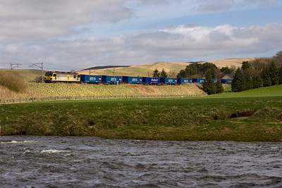 A windy day, 7th April 2011, in the Upper Clyde Valley as a 92 heads north at Crawford with the day's Tesco Express. - Peter Kellet