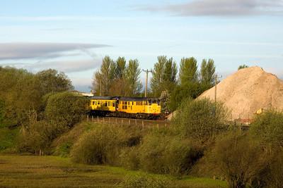 A yellow 31 and test train on 16th April 2011 near Bonnybridge. - Peter Kellet