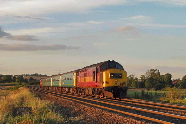 37408 tnt 411 pass burton lane crossing on tonights 31-8-2004 knaresborough-knottingley arriva ecs in the last dregs of beautiful evening sunshine. Image supplied by Carl Beaumont.