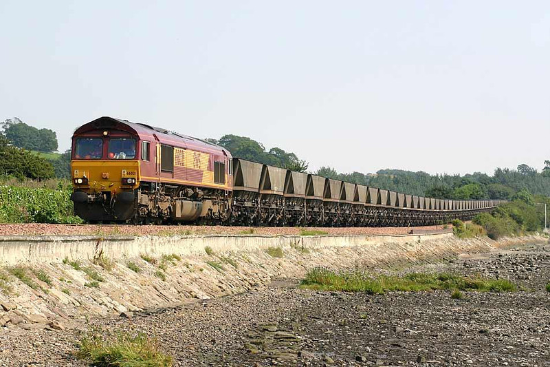 66021 making a ginger decent from Torryburn into Newmills with 7X88 Thornton Yard - Longannet on 8th August 2004. Even with a 85mm lens on the whole train of sixty loaded HAA type wagons would not fit into the frame. Image supplied by Peter Kellett