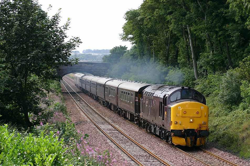 37416 on 1H90 Edinburgh - Keith Royal Scotsman Classic Scotland Tour, approaches Dalgety Bay station running about 25 late. 15th August 2004. Image supplied by Peter Kellett