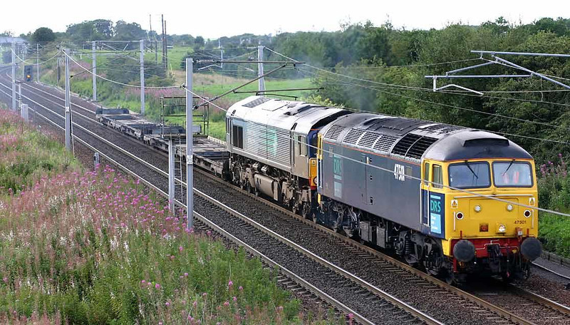Spot which one is Duff. 47501 takes 66403 back to Kingmoor from Grangemouth at Ravenstruther. 25th August 2004. Image supplied by Peter Kellett