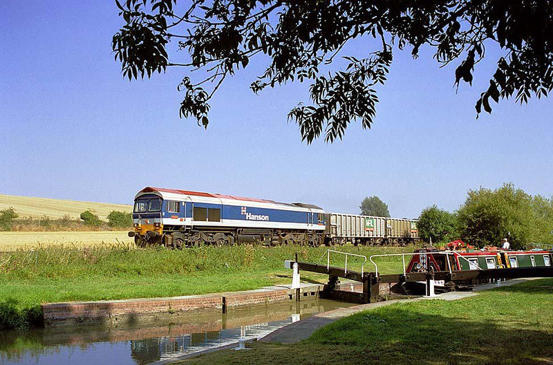 59104 with the 6C77 Acton Yard-Merehead empty bogie boxes between Pewsey & Crofton, Wiltshire. The Kennett & Avon Canal, Sam Farmer's Lock in the foreground (Between East Grafton & Wolfhall Junctions). 4th Sept 2003. Image supplied by Chris Nevard