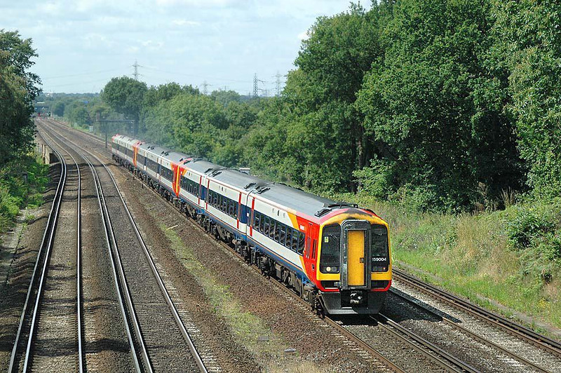 Hello chaps, first post here (I recognize a couple of names) - 159004 Waterloo bound, just south of Weybridge. Mon 19th July 2004. Image supplied by nevardmedia