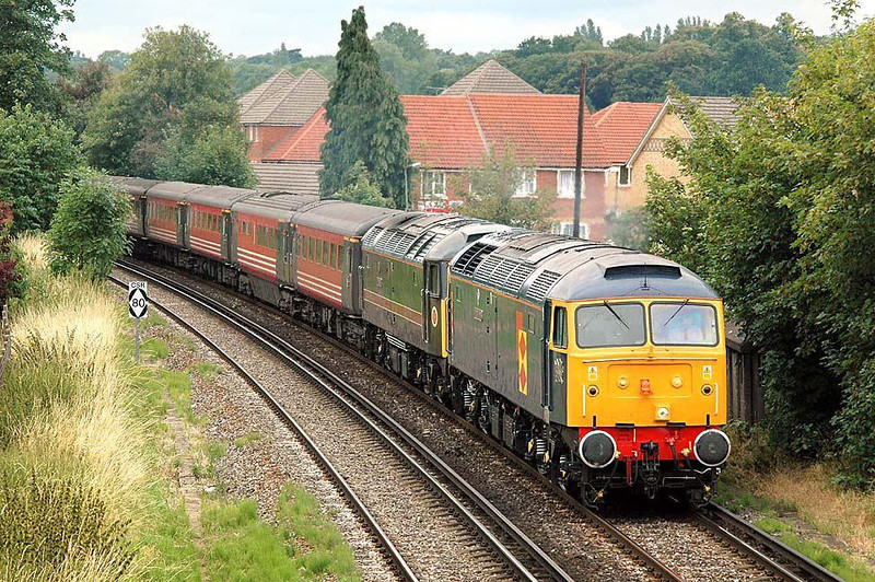 5z59 Poole - Oxley 47145 'Meryddin Emrys' & 47709 (being dragged) passing through Egham. Nikon D70 70-210mm AF Nikkor. 12 July 2004. Image supplied by nevardmedia