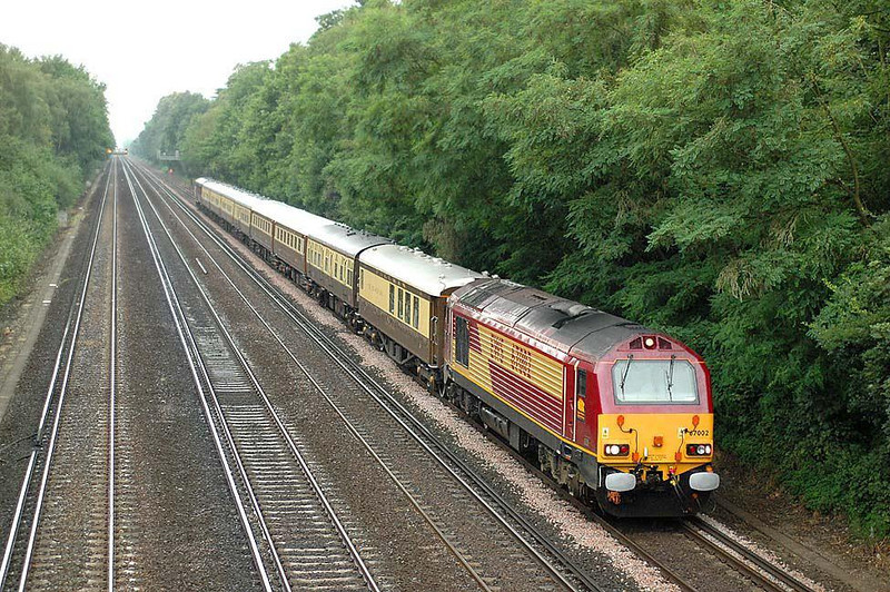 67002 between Woking & West Byfleet with the 1Z90 07.30 Poole-Kensington Olympia diesel hauled segment of the 'Golden Arrow'. Sunday 18th July 2004. Image supplied by nevardmedia