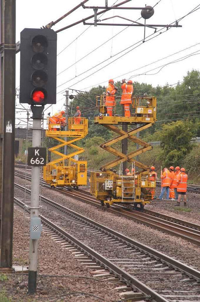 For the specialists out there some Yellow thingys - Two platform lifts repair the OLE at Stevenage after it had an argument with a Eurostar pantograph. Image supplied by rail_net_2k