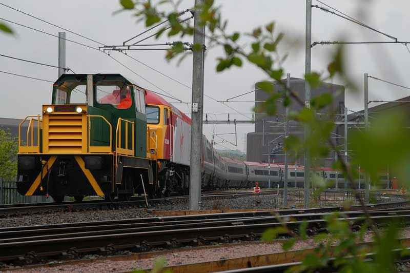 A bizzare combination - Industrial shunter hauls 57308 hauls 390002 out of the Asfordby Test Center. Image supplied by rail_net_2k