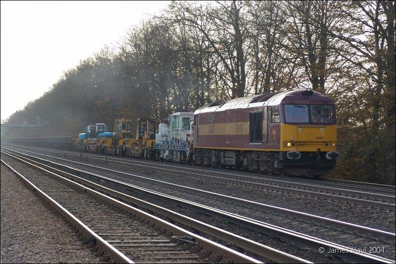 60087 Passes Wallers Ash loop on a UID engineers from Eastleigh to Woking Yard - 5th November 2004.  Image supplied by James Mayl