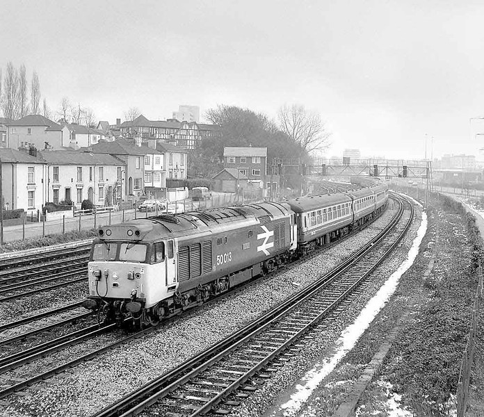 50013 on a diverted Waterloo to Exeter service, seen here departing Southampton on a cold January day in 1984. Rolleicord, Tri-X, neg scan. The most amazing thing is that one can repeat the same view today albeit without loco and train.  Image supplied by Chris Nevard.