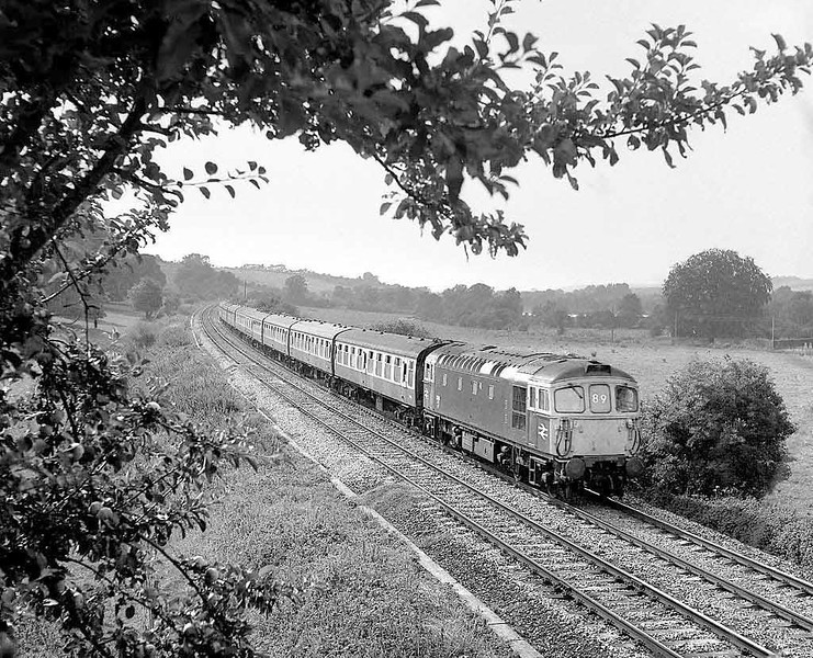 33111 passing Little Langford on the former GWR Wylye Valley Salisbury to Westbury line.  August 1984.  Rolleicord Va Tri-X.  Image supplied by Chris Nevard.