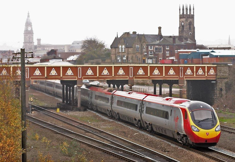 390 leaving Bolton, or is it? (Sorry missed changing the advertising hoardings).  Image supplied by Peter Kellett.