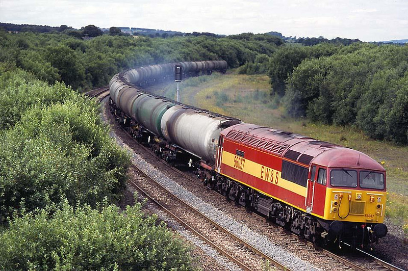 The paint was hardly dry as 56057 brought 6S36 Dalston-Grangemouth empties round the corner at Greenhill Lower, 24th July 1996.  Image supplied by Peter Kellett.