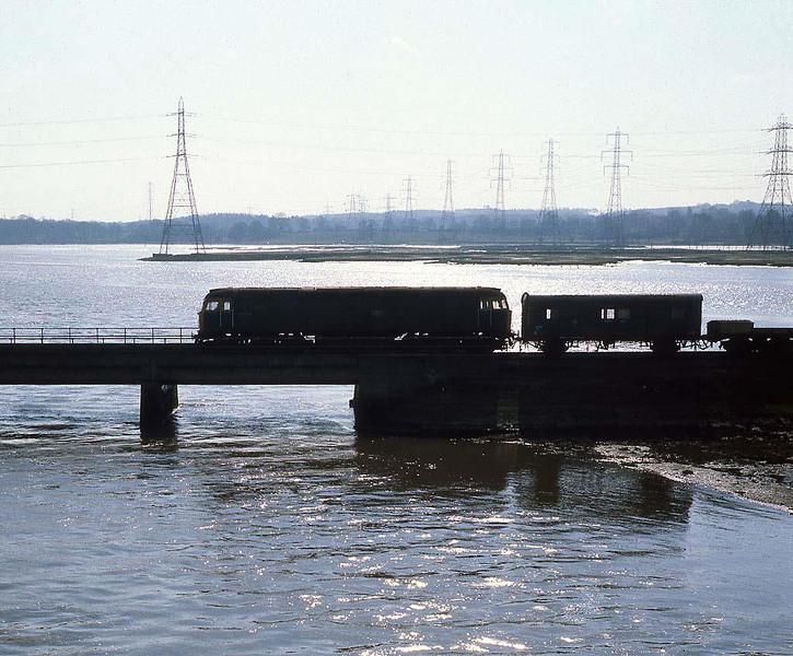 47306 pauses on the bridge crossing the top end of Southampton water, Redbridge. Spring 1983.  Ektachrome 64, Yashicamat 6x6.  Image supplied by Chris Nevard.