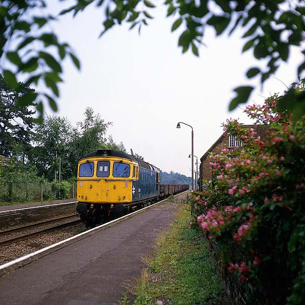 Class 33 on ballast wagons at Botley June 1985.  Image supplied by Chris Nevard.