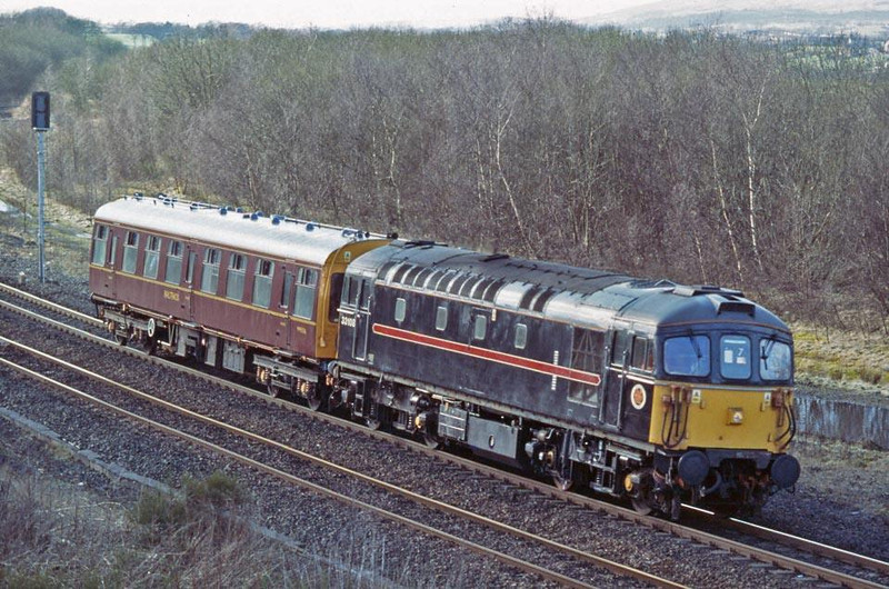 Bagpipes in Scotland. 33108 rounds the bend at Greenhill Lower with 2Z02 Inspection Saloon.  12th March 2002.  Image supplied by Peter Kellett.