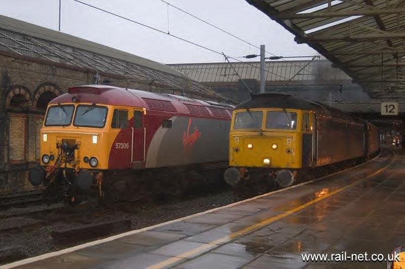 Once their hearts beat the same, now they sing a different tune, 47839 clags its way out of Crewe with a departure for Holyhead with 57306 in the bay. - a shot revisited. Image supplied by Marcus Dawson.