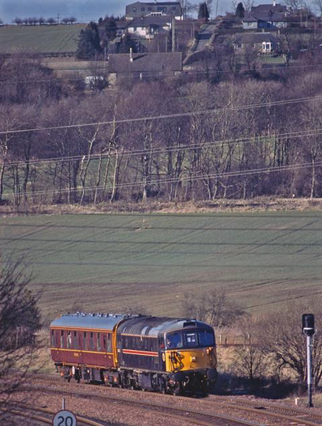 33108 still working 2Z02 waits at Inverkeithing for a clear road over the Forth Bridge.  13th March 2002.  Image supplied by Peter Kellett.
