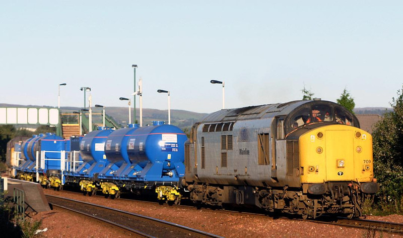 Leafbusters 1 - 37709 heads into the bright sunshine of 24th September 2004 through Camelon station with 1Z93 Millerhill-Millerhill leafbusting train.  Image supplied by Peter Kellett.