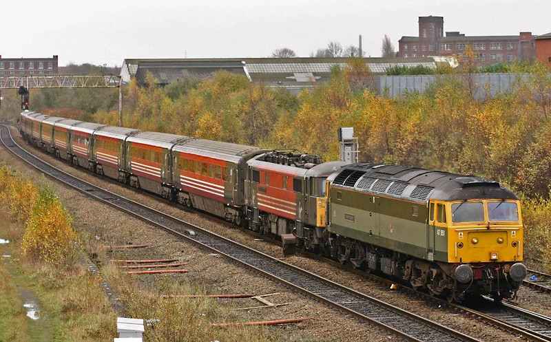 47851 takes 87007 and its Mk3 set towards Preston at Bolton.  7th November 2004.  Image supplied by Peter Kellett.